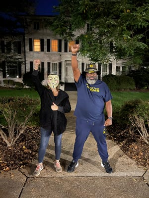 Former University of Michigan football player Jon Vaughn is joined by Larry Nassar survivor Trinea Gonczar as he begins a sit-in outside of President Mark Schlissel's house.