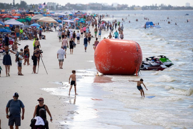 Spectators crowd the beach to watch the 2021 Roar Offshore National Championship on Fort Myers Beach on Saturday, Oct. 9, 2021. Beaches will likely be busy the next week as the weather is forecast to be hot but somewhat dry.