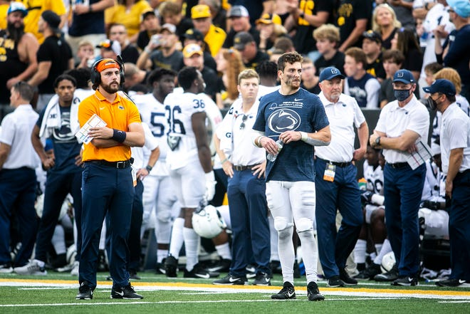 Penn State quarterback Sean Clifford (14) stands on the field without pads during a NCAA Big Ten Conference football game against Iowa, Saturday, Oct. 9, 2021, at Kinnick Stadium in Iowa City, Iowa.