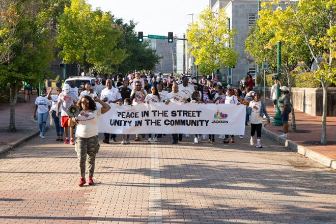 Members of law enforcement and Jackson residents marched through downtown on Saturday, Oct. 9, 2021, to bring the community together to fight against violent crime in the capital city. As of Oct. 9, there have been 114 homicides.