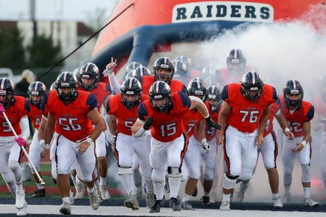 The Harrison Raiders take the field for the first quarter of an IHSAA football game, Friday, Oct. 8, 2021 in West Lafayette.