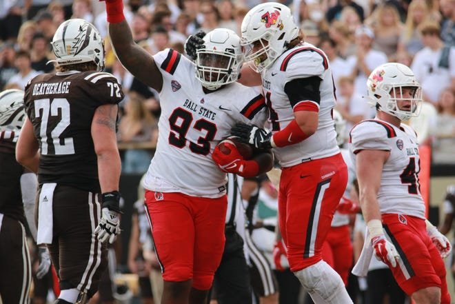 Ball State's Kyron Mims celebrates after recovering a fumble against Western Michigan at Western Michigan Saturday, Oct. 9, 2021.