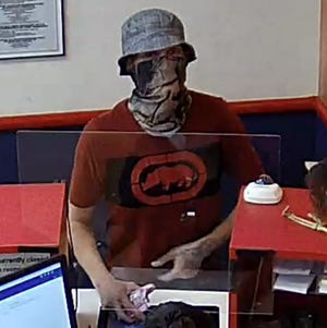 An unidentified suspect is wanted by the FBI for allegedly robbing the First Convenience Bank, inside the Walmart Supercenter at 2701 Carlisle Blvd NE in Albuquerque on the morning of Tuesday, Oct. 5, 2021.