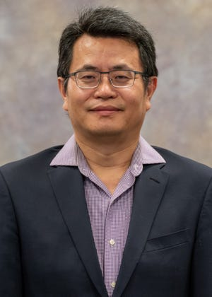 Meng Zhou, assistant professor of chemical and materials engineering, leads the NMSU portion of a four-university, $6 million project to harness carbon dioxide emissions and use them to produce energy and high-value chemicals.
