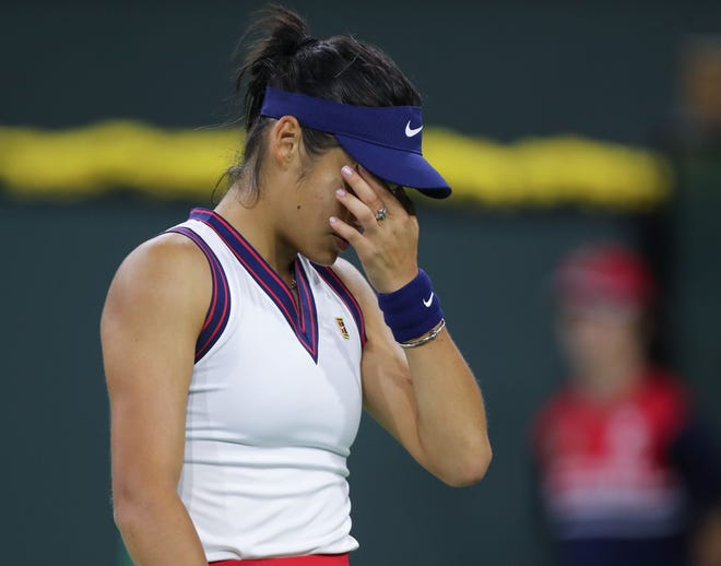 Emma Raducanu reacts to a poor shot during her match against Aliaksandra Sasnovich at the BNP Paribas Open in Indian Wells, Friday, October 8, 2021.