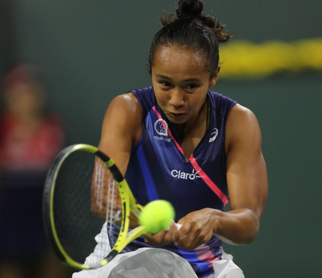 Leylah Fernandez hits a shot against Alize Cornet during their match at the BNP Paribas Open in Indian Wells, Friday, October 8, 2021.