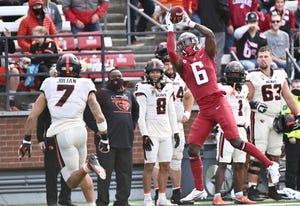 Oct 9, 2021; Pullman, Washington, USA; Washington State Cougars wide receiver Donovan Ollie (6) goes up for a catch against Oregon State Beavers defensive back Alton Julian (7) in the second half at Gesa Field at Martin Stadium. The Cougars won 31-24. Mandatory Credit: James Snook-USA TODAY Sports