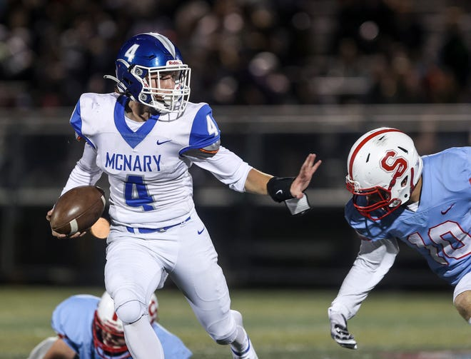 McNary's Gunner Smedema (4) scrambles the ball during the game against South Salem on Friday, Oct. 8, 2021 in Salem, Ore.