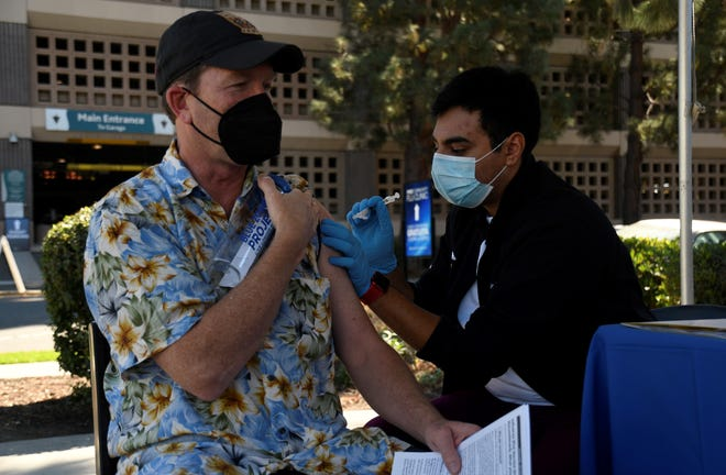 A man receives the influenza vaccine at the SVMH vaccine clinic.