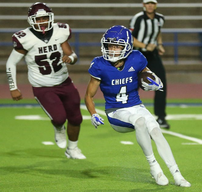 Lake View's Brandon Cruz, right, fights for yardage against Hereford at San Angelo Stadium on Friday, Oct. 8, 2021.