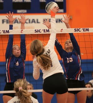 San Angelo Central's Morgan Strain, far left, and Amory Fly try to block a shot by Midland High at Babe Didrikson gym on Friday, Oct. 8, 2021.