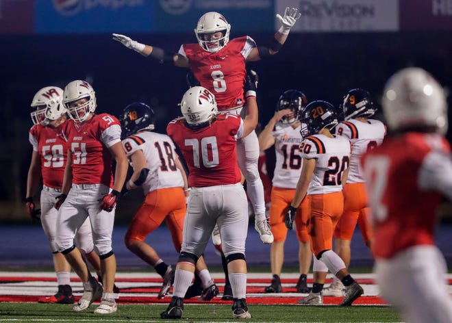 Wisconsin Rapids Lincoln's Leo Brostowitz (8) celebrates with Luke Hafermann (70) after scoring a touchdown against Marshfield on Friday in Wisconsin Rapids.