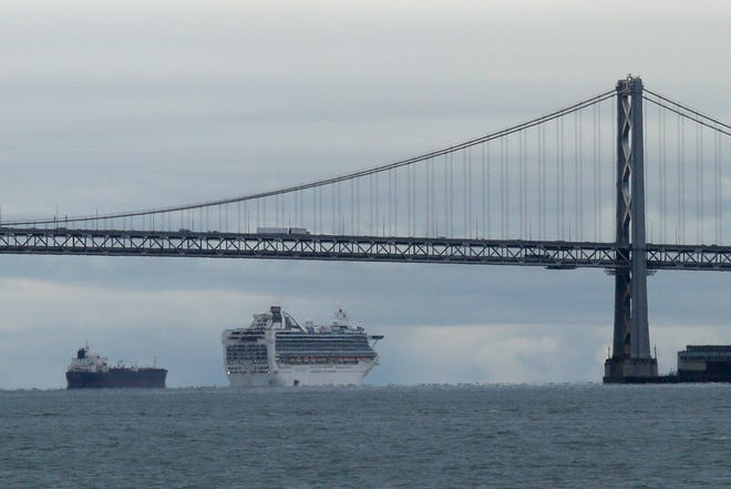 The Majestic Princess will sail from Los Angeles for a weeklong California coast voyage that will include an overnight stop in San Francisco.  In this March 16, 2020, file photo, the Grand Princess cruise ship makes its way to an anchorage in San Francisco.