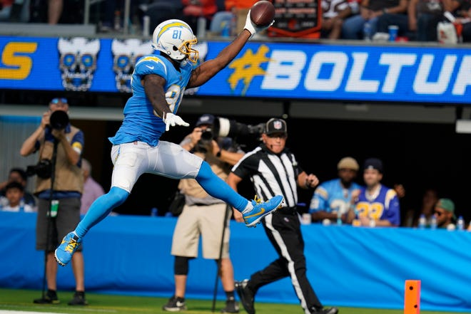 Los Angeles Chargers wide receiver Mike Williams leaps into the end zone to score a touchdown during the second half of an NFL football game against the Cleveland Browns Sunday, Oct. 10, 2021, in Inglewood, Calif. (AP Photo/Gregory Bull)