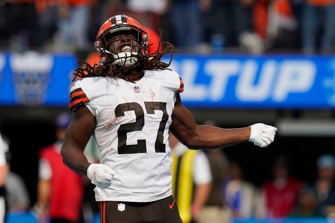 Browns running back Kareem Hunt (27) celebrates his rushing touchdown during the first half of a 47-42 loss to the Los Angeles Chargers on Sunday. [Gregory Bull/Associated Press]