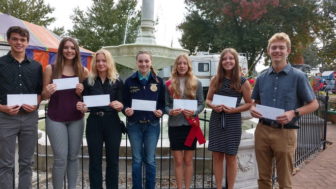 Kettering Scholarships were presented Saturday at the Loudonville Fair to Loudonville High School seniors, from left, Conner Portz, Alison Barr, Catlyn Kauffman, Zoie Lozier, Jenna Book, Sydney Fry and Ashton Henley.