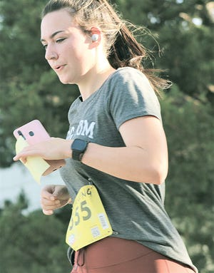 Shawnee Bates starts the final stage of Saturday's Chasin Bacon 5K run in Bartlesville.
