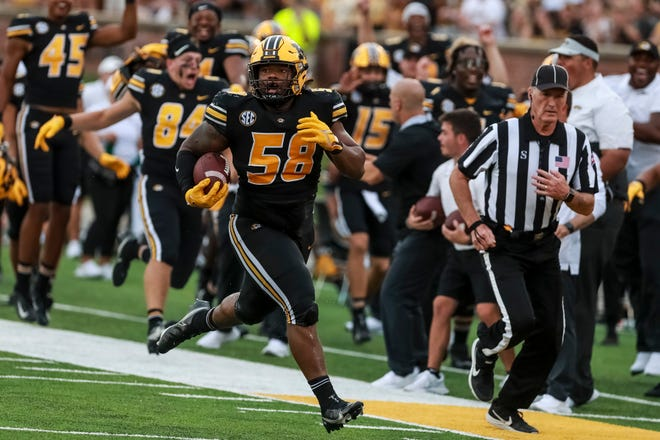Missouri defensive lineman Mekhi Wingo (58) intercepts a pass for a touchdown during the second half of the Tigers' game against North Texas last Saturday at Faurot Field.