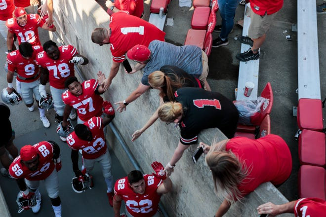 Ohio State Buckeyes players greet fans as they leave the field following their 66-17 victory against the Maryland Terrapins during a NCAA Division I football game on Saturday, Oct. 9, 2021 at Ohio Stadium in Columbus, Ohio.