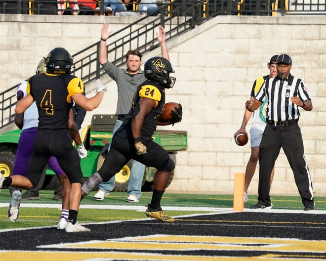 Adrian College running back Steven Moses (24) crosses the goal line to score a touchdown in the first quarter of the Bulldogs' 21-7 victory over MIAA rival Albion College on Saturday evening at Docking Stadium.
