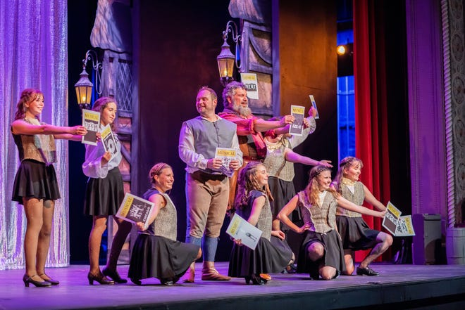 """Cast members of """"Something Rotten"""" sing """"A Musical,"""" a pastiche of musical-theater tropes, in a scene from the Croswell Opera House's production."""