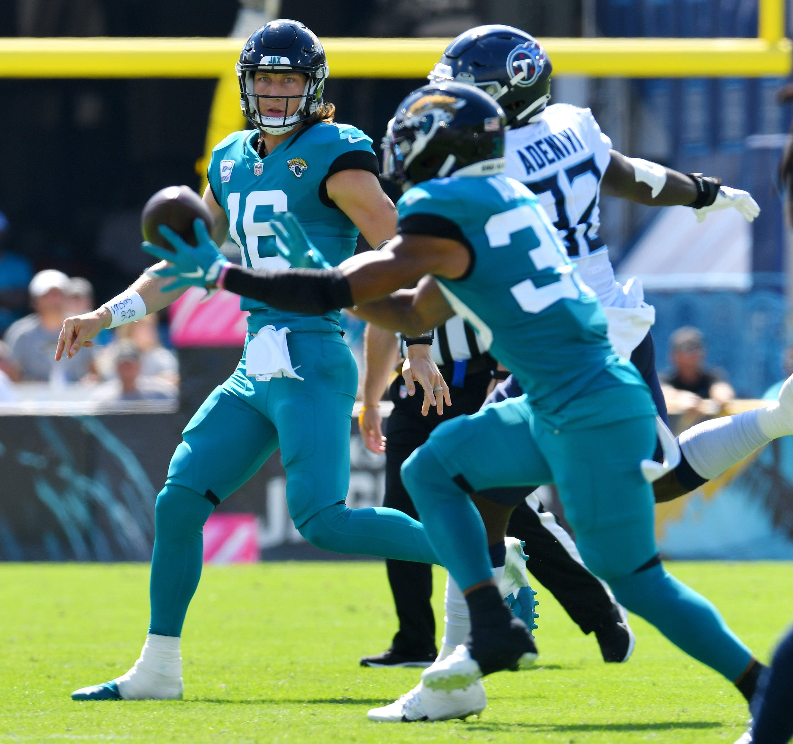 Jacksonville Jaguars quarterback Trevor Lawrence (16) launches an early second quarter pass to Jacksonville Jaguars wide receiver Jamal Agnew (39) against the Tennessee Titans on October 10, 2021. [Bob Self/Florida Times-Union]