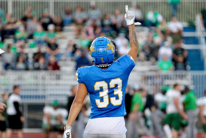 Hutchinson Salthawks senior defensive back Devon Hackney points up as he remembers his father, Vincent, when he stepped onto the field Friday, Oct. 1, 2021 at Gowans Stadium.