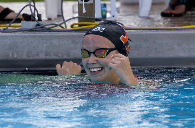 Lakeland senior Lutnya Bogdanova reacts after seeing her record-breaking time in the 100-yard breaststroke on Saturday at the 2021 Polk County Swim/Dive Championships at Rowdy Gaines Pool. She earlier set a record in the 100 butterfly.