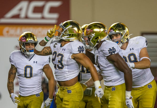Notre Dame running back Kyren Williams (23) celebrates a touchdown during ND's 32-29 win over Virginia Tech, Saturday, Oct. 9, 2021, in Blacksburg, Va.