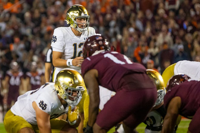 Notre Dame's Tyler Buchner (12) at quarterback during the Notre Dame-Virginia Tech NCAA college football game on Saturday, Oct. 9, 2021, in Blacksburg, Va.
