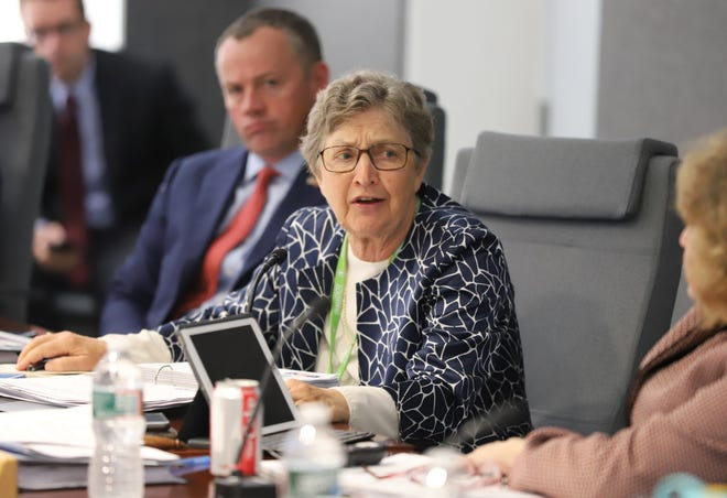 Betsy Taylor speaks at a joint meeting of the MassDOT Board of Directors and the MBTA Fiscal and Management Control Board in 2019. Sam Doran/SHNS