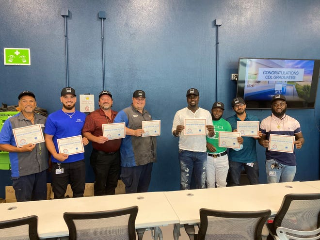 Mike Suprata, left, George Rivera, Shane Welch, Bryan Raby, Jean Pierre, Faby Marcellus, Eloy Ybarreche and Jef Rampart graduated from PGT's new Commercial Driver's License training program.