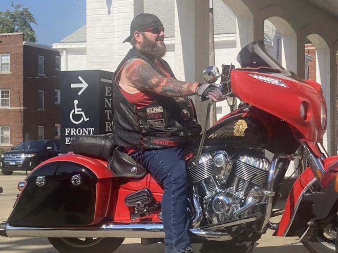 Ken Burton of Springfield gets ready to depart the Staab Funeral Home parking lot as part of the Ride in Honor Sunday. Riders and others were making stops at Camp Butler National Cemetery, Spaulding Veterans Memorial, Oak Ridge Cemetery and the New Berlin Area Veterans Memorial.