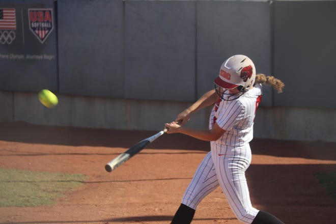 Haley Hacker leads off the game by smashing this home run against Dewey Friday in the semifinals.