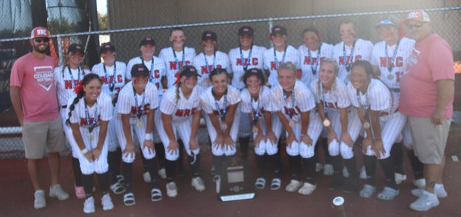 The North Rock Creek Lady Cougars pose with their state runner-up trophy on Saturday.