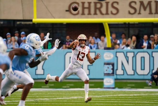 Oct 9, 2021; Chapel Hill, North Carolina, USA;  Florida State Seminoles quarterback Jordan Travis (13) throws the ball against the North Carolina Tar Heels during the second half at Kenan Memorial Stadium. Mandatory Credit: James Guillory-USA TODAY Sports