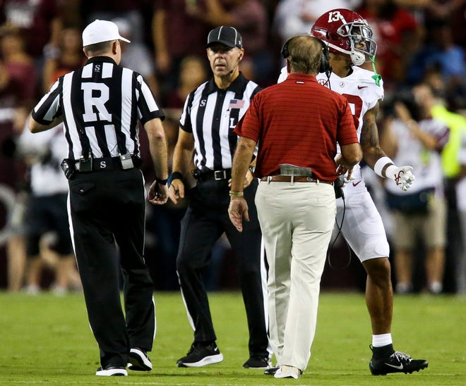 Oct 9, 2021; College Station, Texas, USA;  Alabama defensive back Malachi Moore (13) is ejected from the game after a targeting foul against Texas A&M at Kyle Field. Mandatory Credit: Gary Cosby Jr.-USA TODAY Sports