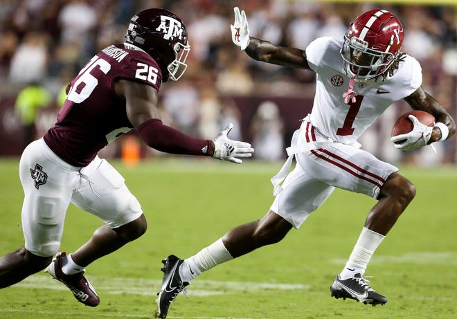 Oct 9, 2021; College Station, Texas, USA;  Alabama wide receiver Jameson Williams (1) stiff arms Texas A&M defensive back Demani Richardson (26) at Kyle Field. Mandatory Credit: Gary Cosby Jr.-USA TODAY Sports