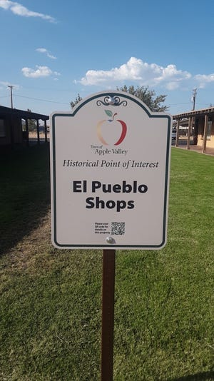 The new historical site sign outside the El Pueblo Shops in Apple Valley.
