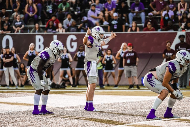 ACU quarterback Stone Earle, center, gets ready to run a play during the Wildcats' game against Eastern Kentucky on Saturday in Richmond, Kentucky.