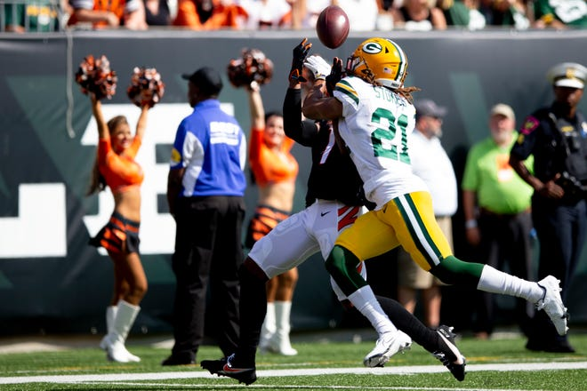 Green Bay Packers cornerback Eric Stokes (21) deflects a pass intended for Cincinnati Bengals wide receiver Ja'Marr Chase (1) in the first half of the NFL football game between the Cincinnati Bengals and the Green Bay Packers on Sunday, Oct. 10, 2021, at Paul Brown Stadium in Cincinnati.