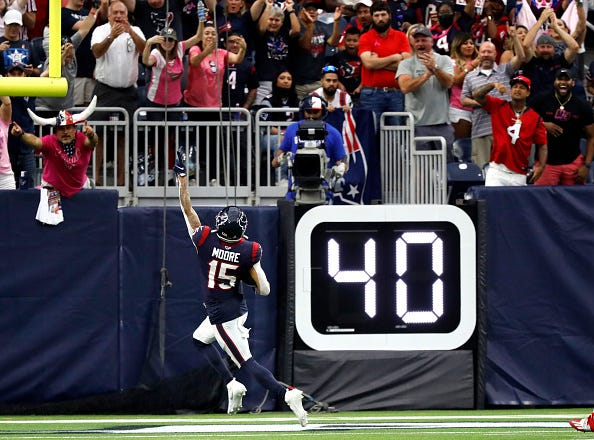 Chris Moore of the Houston Texans celebrates a first-half touchdown against the New England Patriots at NRG Stadium in Houston on Sunday, Oct. 10, 2021.