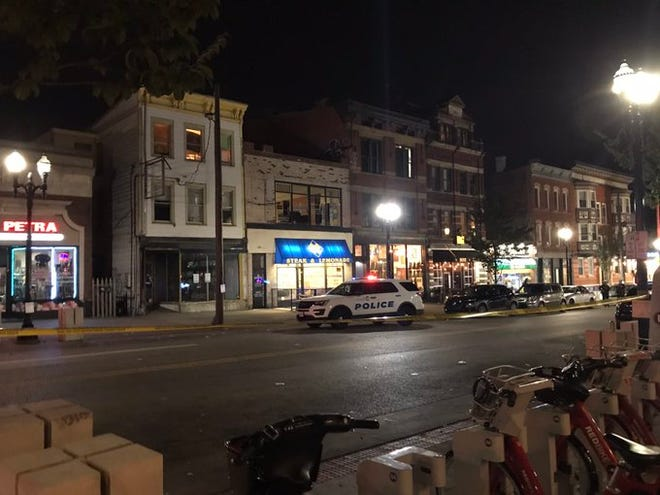 Police say three people were injured after an argument turned into a shooting near the University of Cincinnati.