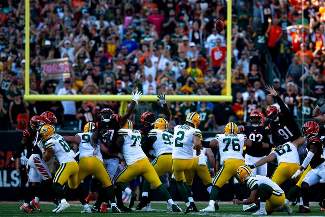 Green Bay Packers kicker Mason Crosby (2) hits a fieldgoal to win the NFL football game between the Cincinnati Bengals and the Green Bay Packers in overtime 25-22 on Sunday, Oct. 10, 2021, at Paul Brown Stadium in Cincinnati.