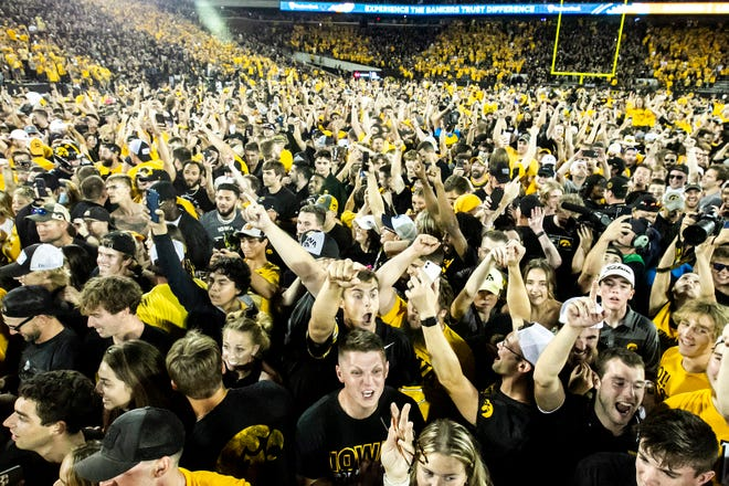 Iowa Hawkeyes fans celebrate after a NCAA Big Ten Conference football game against Penn State, Saturday, Oct. 9, 2021, at Kinnick Stadium in Iowa City, Iowa. Iowa beat Penn State, 23-20.