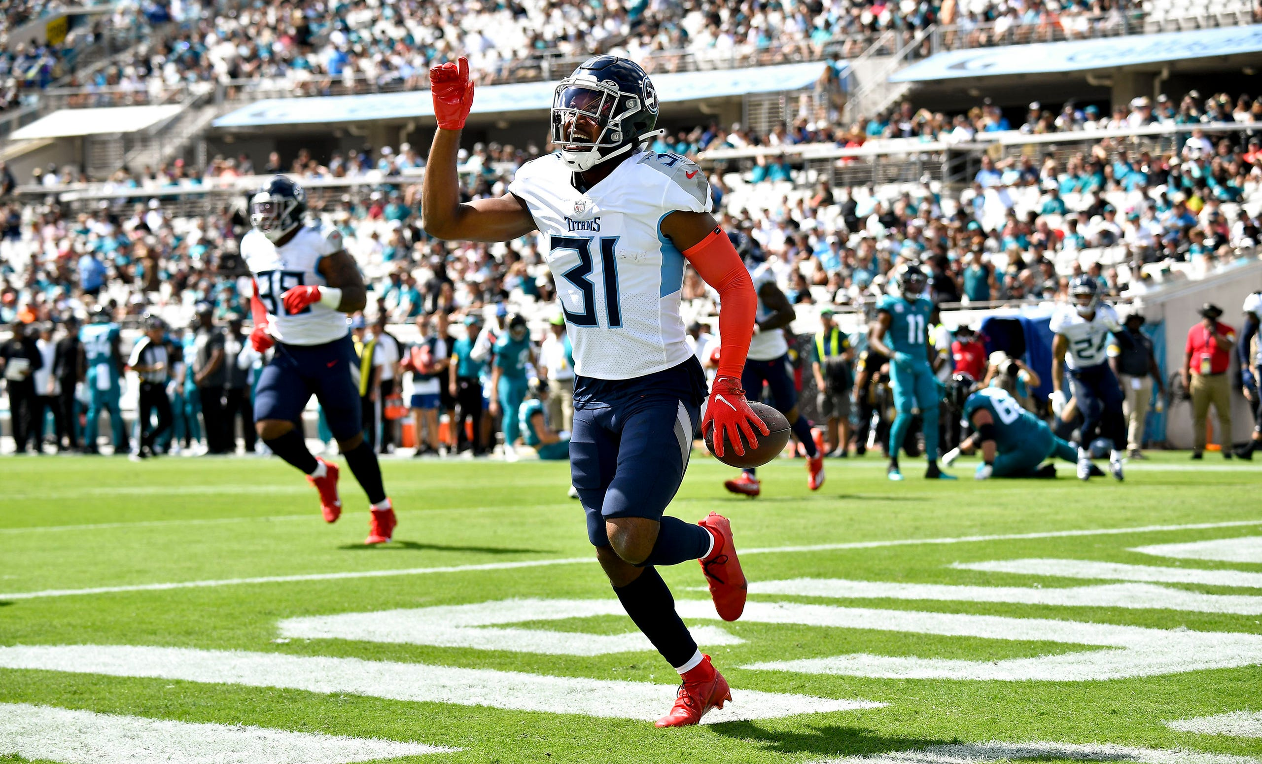 Tennessee Titans free safety Kevin Byard (31) scores a touchdown after recovering a fumble during the first quarter of the game at TIAA Bank Field Sunday, Oct. 10, 2021 in Jacksonville, Fla.