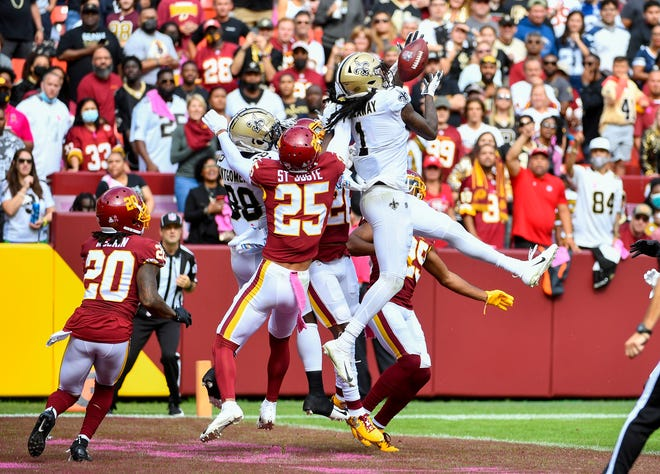 New Orleans Saints wide receiver Marquez Callaway (1) catches a touchdown  pass against the Washington Football Team during the first half Sunday, Oct. 10, 2021, at FedExField.