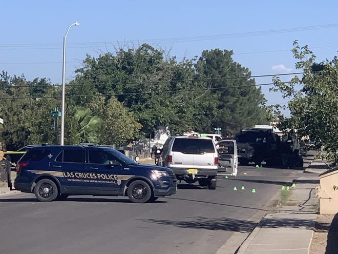 Las Cruces police close the intersection of Fourth Street and Davis Avenue on Sunday, Oct. 10, 2021, while investigating a shooting that happened the night before.