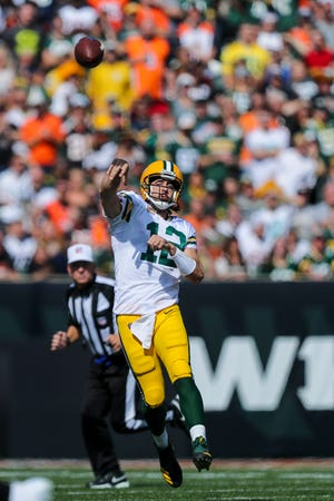 Green Bay Packers quarterback Aaron Rodgers throws a pass against the Cincinnati Bengals in the first half on Oct. 10, 2021, at Paul Brown Stadium.