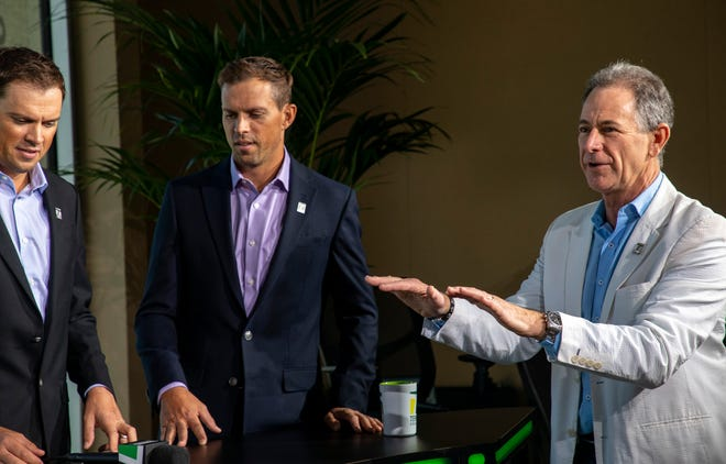 Tennis Channel CEO Ken Solomon chats with broadcasters on set during the BNP Paribas Open, Sunday, Oct. 10, 2021, in Indian Wells, Calif.
